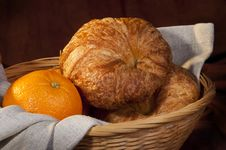 Croissant Served For Breakfast With Orange Fruit Stock Images
