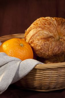 Croissant Served For Breakfast With Orange Fruit Royalty Free Stock Images