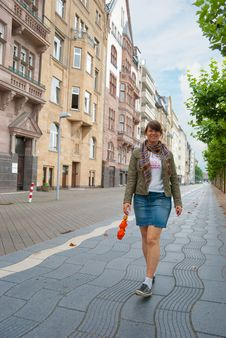Free Young Girl Walking Down The Street Stock Photos - 17754043