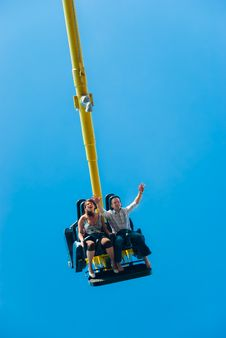 Couple Riding On The Attraction Royalty Free Stock Images