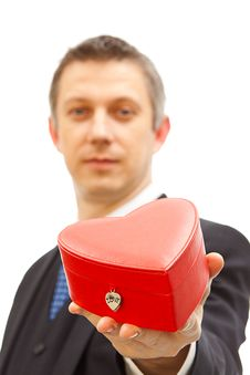 Free Handsome  Man Holding A Red Heart Box Royalty Free Stock Images - 17758069
