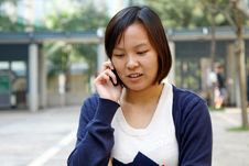 Free Chinese Girl Who Is Talking In Phone Royalty Free Stock Photo - 17758225