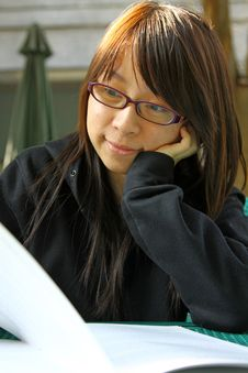 Free Chinese Girl Who Is Reading Books Stock Image - 17758531