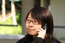 Free Chinese Girl Who Is Talking In Phone Royalty Free Stock Photography - 17758757