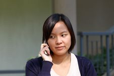 Free Chinese Girl Who Is Talking In Phone Royalty Free Stock Photo - 17758785