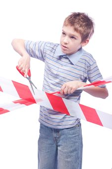 Free Boy With Scissors Behind Cordon Tape Royalty Free Stock Photo - 17759045