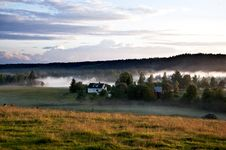 The Fog Slips In Among The Houses Royalty Free Stock Photos