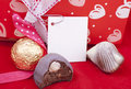 Free Sweets Against Celebratory Packing With A Label Stock Photos - 17763103