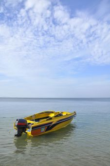 The Yellow Boat In The Sea Stock Photos
