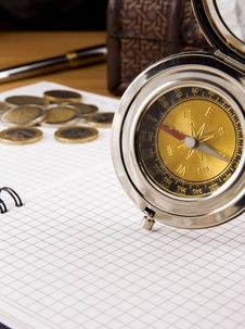 Free Compass, Gold Coin And Pen On Notebook Stock Images - 17760224
