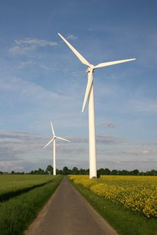 Free Wind Farm With Rape Field Royalty Free Stock Image - 17760756