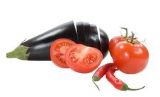 Red Tomatoes Chilly Peppers And Aubergine Royalty Free Stock Images