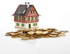 Miniature  House  With The Coins Stock Image