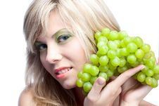 Young Girl With Grape Royalty Free Stock Photography