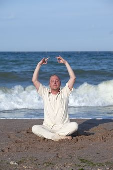 Free Young Businessman Doing Yoga On A Beach Stock Image - 17768551