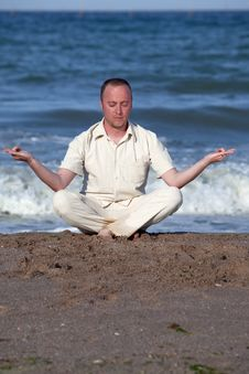 Free Young Businessman Doing Yoga On A Beach Stock Images - 17768574