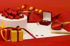 Free Box With A Gift On A Red Fabric Royalty Free Stock Images - 17769989