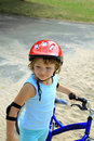 Free Little Girl In A Red Helmet Stock Photography - 17773832