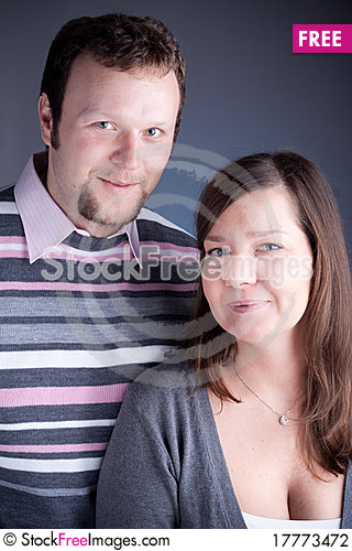 Free Couple Hugging Each Other Against Grey Backround Stock Photography - 17773472