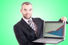 Business Man Pointing At A Laptop With Graph Royalty Free Stock Images