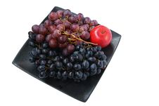 Two Ripe Clusters Of Grapes And One Red Apple Stock Image