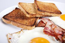 Free Breakfast - Toasts, Eggs, Bacon Royalty Free Stock Images - 17776359