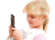 Free Girl Looking At Mobile Phone Royalty Free Stock Photos - 17778068