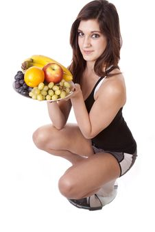 Free Woman On Scale With Fruit Happy Stock Photography - 17782122