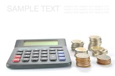 Free Calculator With Row Of Coins Stock Image - 17785181
