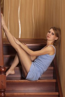 Portrait Beautiful Blonde Sits On Ladder Royalty Free Stock Images