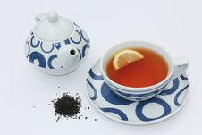 Teacup And Teapot With Loose Tea Leaves Stock Photos