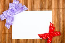 Violet And Red Bows With Paper Card Royalty Free Stock Photography