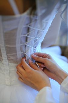 Free Hands Helping With Bride S Corset Stock Image - 17789891