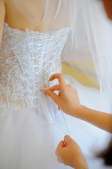 Free Hands Helping With Bride S Corset Stock Photos - 17789913