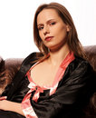 Free Pretty Young Woman Sitting On Leather Couch Royalty Free Stock Photography - 17795557