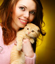 Free Woman With Red England Lop-eared Kitten Stock Images - 17798634