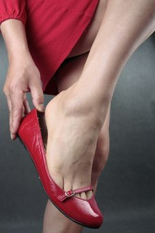 Free Woman Legs Red Heels Over Grey Stock Image - 17791791