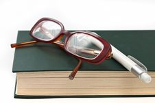 Free Glasses On Book And Pen Stock Image - 17791841