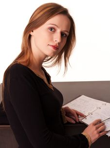 Free Pretty Young Girl Sitting At The Desk Royalty Free Stock Photography - 17795487