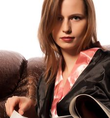 Free Young Woman Sitting On Sofa Reading Magazine Royalty Free Stock Photos - 17795558