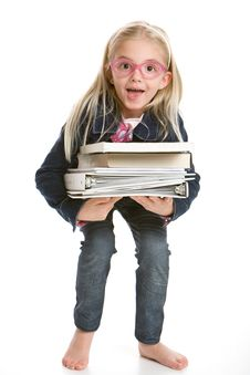 Free Cute Little Girl Holding Books Stock Photography - 17795872