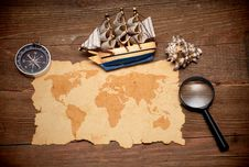 Model Classic Boat, Compass And Loupe Royalty Free Stock Photos