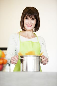 Free Woman Preparing Spaghetti In Pot Stock Image - 17796301