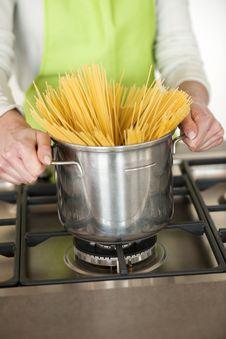 Free Woman Preparing Spaghetti In Pot Stock Images - 17796444