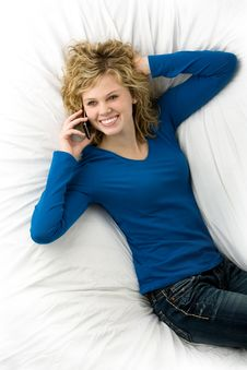Free Cute Teenage Girl Lying Down Talking On Phone Royalty Free Stock Photography - 17797177