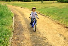 Free A Little Girl Rides A Bike In The Park Stock Photos - 17797553