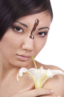 Free The Girl With Lily, Chocolate On His Face. Royalty Free Stock Photography - 17797987