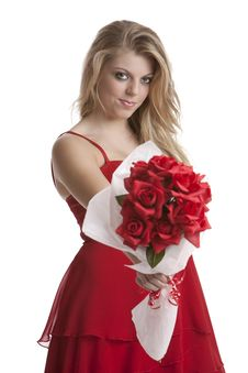Free Teenage Girl In A Red Dress Holding A Bouquet Royalty Free Stock Photos - 17798358