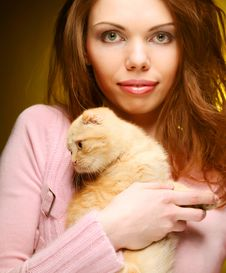 Free Woman With Red England Lop-eared Kitten Royalty Free Stock Images - 17798639