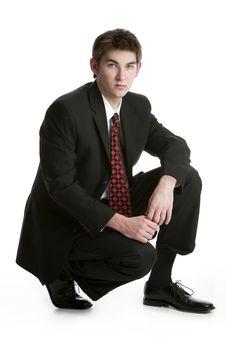 Free Attractive Teenage Boy Kneeling In A Suit Stock Photo - 17799110